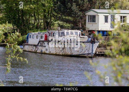 Old Wooden Run Down Vintage House Boat/Cruiser Moored on the River Trent in Nottinghamshire.England - Stock Photo