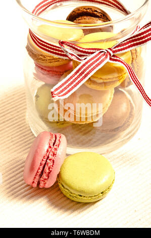 colorful macarons or French macaroons in a retro glass jar
