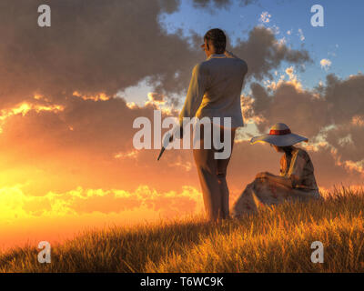 A man with a gun and a woman, dressed in light summer clothes, watch the sunset from a grassy hillside. - Stock Photo