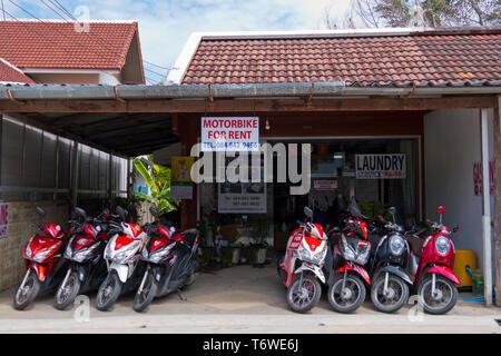 Motorbike and scooter rental shop, Rim Hat Road, Kamala, Phuket island, Thailand - Stock Photo