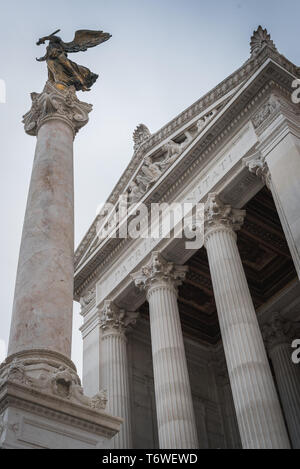 Column and statue at the entrance of the Vittorio Emanuele II monument in Rome Italy - Stock Photo