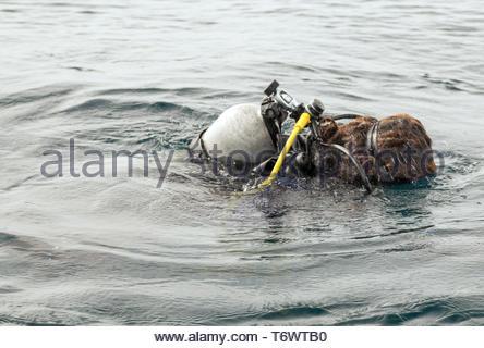 Underwater Scuba Diver Oxigen tank Swimming in wetsuit neoprene - Stock Photo
