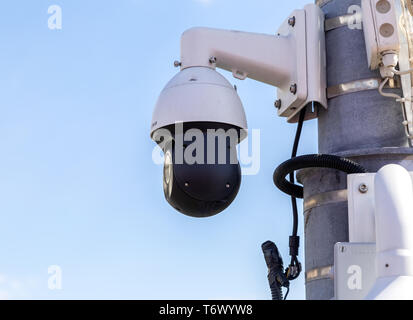 Samara, Russia - May 1, 2019: Surveillance CCTV cameras mounted on post against the blue sky - Stock Photo