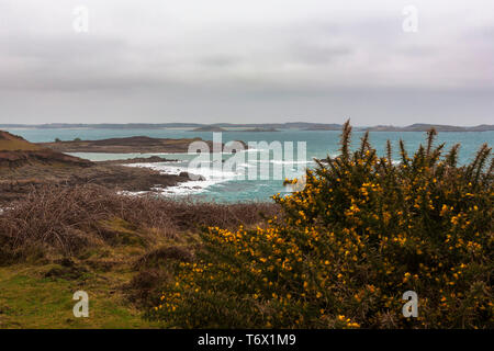 View across Crow Sound to the Eastern Isles from Gap Point, St. Mary's, Isles of Scilly, UK on a windy and overcast day - Stock Photo
