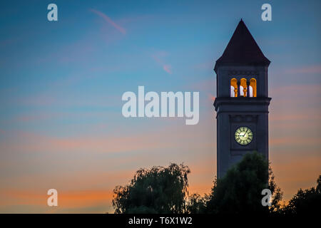 spokane downtown clock tower in park at sunset - Stock Photo