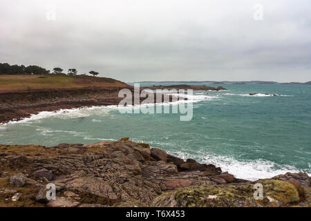 View across Darrity's Hole, Toll's Island and over Crow Sound to the Eastern Isles from Gap Point, St. Mary's, Isles of Scilly, UK on a windy day - Stock Photo