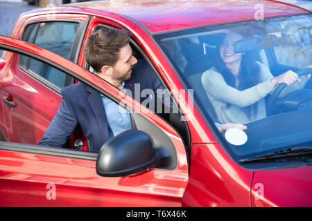 Handsome Man In Suit Getting In Car - Stock Photo
