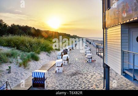 Beach with beach chairs on the pier in Zinnowitz. Usedom Island. - Stock Photo