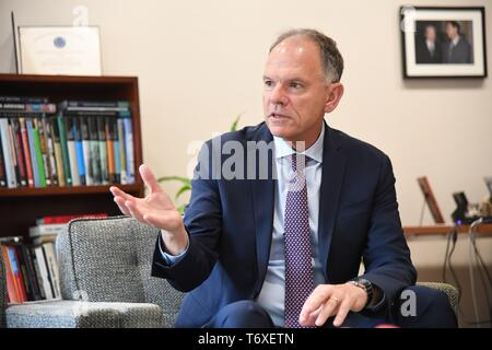 Philadelphia, USA. 19th Apr, 2019. Geoffrey Garrett, dean of the Wharton School at the University of Pennsylvania, speaks to Xinhua during an exclusive interview in Philadelphia, the United States, April 19, 2019. Technology competition between the United States and China won't lead to so-called 'decoupling' because the two economies are 'tightly integrated,' said Geoffrey Garrett. TO GO WITH Interview: U.S.-China technology competition won't lead to 'decoupling,' says Wharton dean Credit: Yang Chenglin/Xinhua/Alamy Live News - Stock Photo