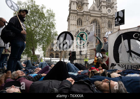 London, UK. 3rd May, 2019. Anti-nuclear activists protest by lying on ground outside Westminster Abbey during the Thanksgiving service for the Navy. Credit: Lexie Harrison-Cripps/SOPA Images/ZUMA Wire/Alamy Live News - Stock Photo