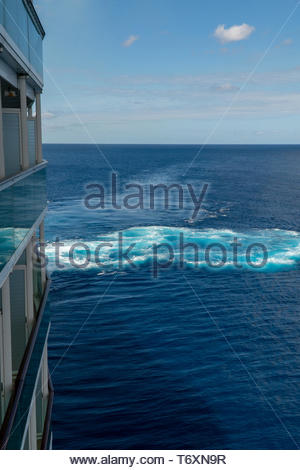 A cruise ship creates a turbulent wake with a transverse thruster while docking In Barbados, an island Commonwealth Realm in the North Atlantic in the - Stock Photo