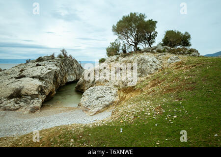 Small bay of Sveti Blaz (island Cres, Croatia) on a cloudy day in spring - Stock Photo