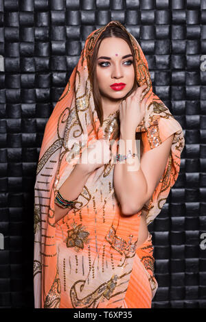 Portrait of Indian young woman - Stock Photo