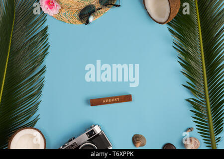 Creative Flat lay fashion style with camera, sunglasses and panama hat on pastel blue color background - Stock Photo