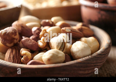 Different nuts in wooden bowl, closeup - Stock Photo