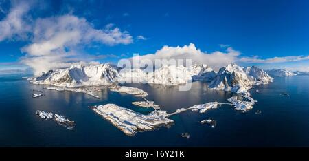 View to the villages Reine, Sakrisoy and Hamnoy, snowy mountains and fjords, Olstinden, Moskenesoya, Lofoten, Norway - Stock Photo