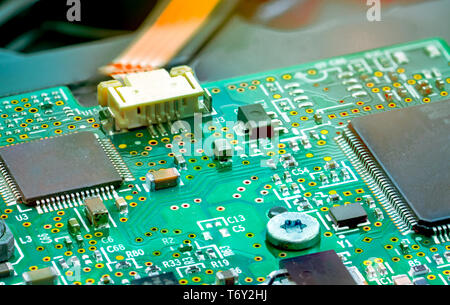 Electronic circuit board. Mainboard of computer. Computer integrated circuit board. Detail of electronic circuit board. Memory of digital information  - Stock Photo