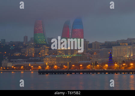 BAKU, AZERBAIJAN - JANUARY 04, 2018: View of the Flame Towers on a gloomy January evening - Stock Photo