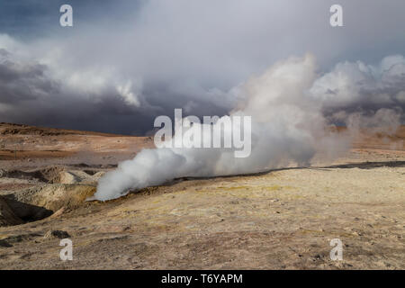 Steam rising from a geyser in Altiplano, Bolivia - Stock Photo