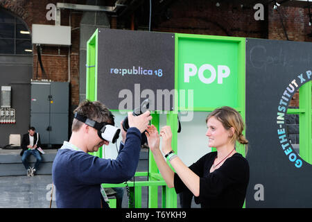Berlin, Germany - May 3, 2018: A visitor of the re: publica tests virtual reality equipment at the stand of the goethe institute. re:publica is a conf - Stock Photo