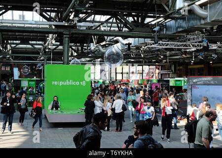 Berlin, Germany - May 3, 2018: View on the entrance hall of re:publica 2018 with visitors and many small booths. re:publica is a conference about Web  - Stock Photo