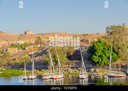 View of Elephantine Island, sailing feluccas and ancient ruins on  River Nile, aswan egypt - Stock Photo