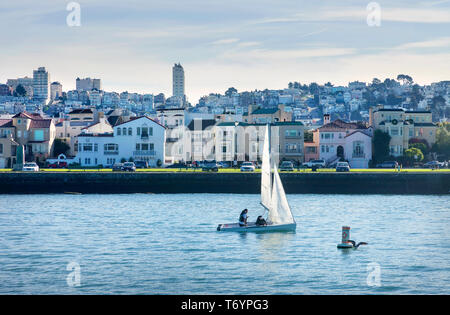 Sailing San Francisco Bay, SAN FRANCISCO, CA - DECEMBER 10, 2017: The image is of a small sail boat taking a trip in front San Francisco's Marina dist - Stock Photo
