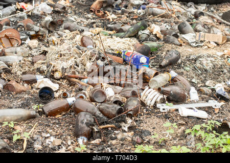 Beer bottles and garbage in general  dumped on the side of the road in Yucatan, Mexico. - Stock Photo