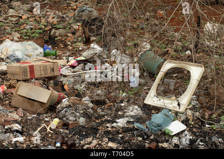 Dump on the side of the road in Yucatan, Mexico. We can see glass bottles, plastic objects and bags, and other pollutants. Stock Photo