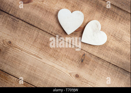 Two wood heart on a vintage wooden background. - Stock Photo