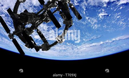 International Space Station in outer space over the planet Earth - Stock Photo