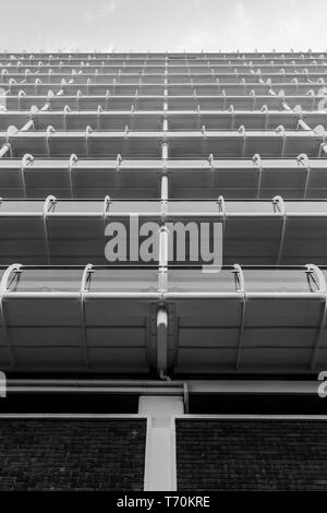 Looking up at the balconies on a high rise apartment block in Northampton town centre. - Stock Photo