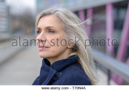 Serious woman looking intently to the side - Stock Photo