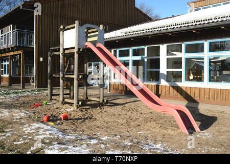 Children's slide in front of the kindergarten - Stock Photo