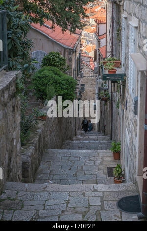 Narrow downhill passage in Dubrovnik Old town - Stock Photo
