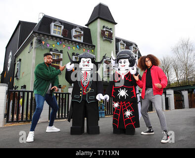Hair-raising flips and tricks from dancing Diversity duo Jordan Banjo (26) and Perri Kiely (23). The pair were invited down to the LEGOLAND® Windsor Resort for a sneak peek of the new ride – The Haunted House Monster Party – ahead of its grand opening on 13 April 2019.  Whilst at LEGOLAND, the boys – who are no strangers to spending time flipped upside down as part of their impressive dance careers – showed off their gravity-defying skills and signature party tricks around the Resort as it prepares for the ride's opening. They were spotted performing flips outside the front of the Haunted Hous - Stock Photo