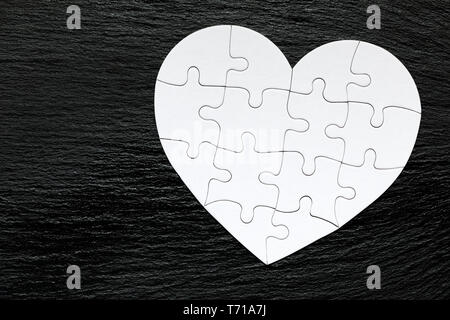 Heart object made of puzzle pieces. Make complete heart. Jigsaw puzzle pieces in form of heart. Happy Valentines Day, greeting card template. Heart ji - Stock Photo