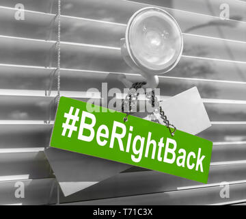 Hashtag 'Be right back' on a glass door with a white, closed venetian blind. It can be used for business concepts or backgrounds. - Stock Photo