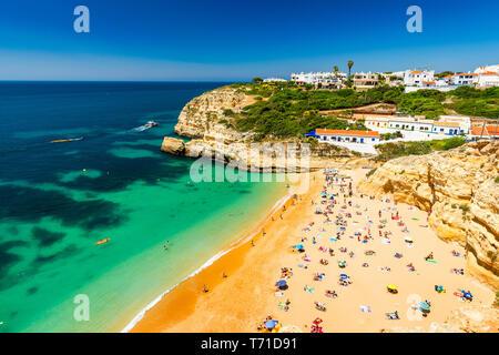 Benagil beach in Algarve region, Portugal, Europe. View of beach in Benagil fishing village on coast of Portugal. Praia de Benagil beach on atlantic c - Stock Photo