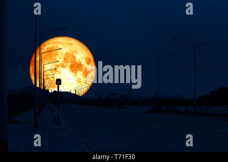 super blood moon back on silhouette industry road night sky, Elements of this image furnished by NASA - Stock Photo
