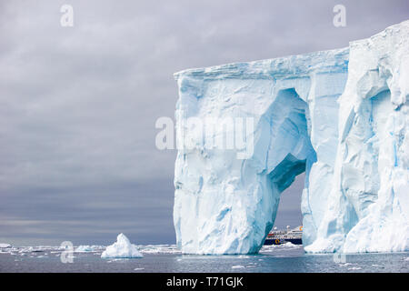Iceberg Carving near Crystal Sound Antarctica as seen from a Zodiac Boat - Stock Photo