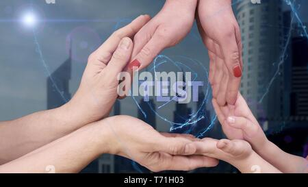 Men's, women's and children's hands show a hologram Test - Stock Photo