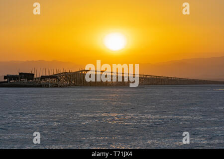 Sunset on the salt plains of Asale Lake in the Danakil Depression in Ethiopia, Africa - Stock Photo