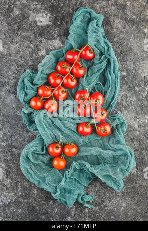 Fresh cherry tomatoes on a black background. - Stock Photo