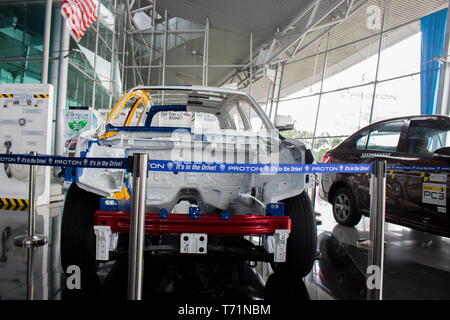Proton damaged car for show inside the main company. - Stock Photo