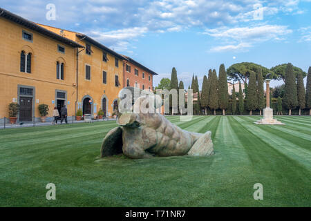 PISA, TUSCANY/ITALY  - APRIL 17 : Fallen Angel at the Square of Miracles in Pisa Tuscany Italy on April 17, 2019. Three unidentified people - Stock Photo