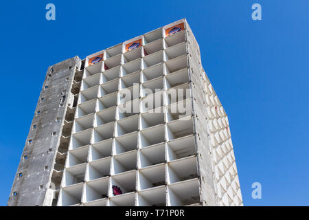 Emptied tall concrete block demolition site in Vienna, Austria, low angle view - Stock Photo