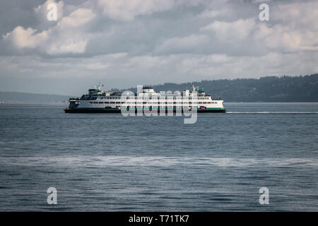 The ferry Walla Walla makes its way on a cloudy summer day from Bainbridge Island to Seattle in the Puget Sound, Washington state. - Stock Photo