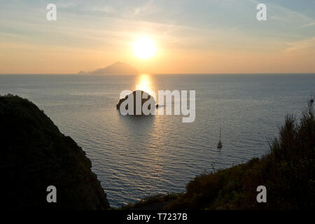 Sunset on Filicudi Island from Pollara, Salina, Aeolianislands,  Sicily, Italy - Stock Photo
