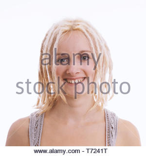 happy young woman with blond dreadlocks and tooth gap - Stock Photo